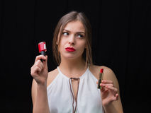 Woman with a nail polish and a red lipstick Stock Images
