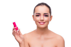 The woman with nail polish tube isolated on white Royalty Free Stock Photo