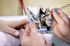 Woman in nail salon Stock Photography