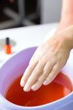 Woman in nail salon having paraffin bath royalty free stock photos