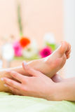 Woman in nail salon receiving foot massage Stock Photography