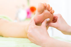 Woman in nail salon receiving foot massage Royalty Free Stock Image