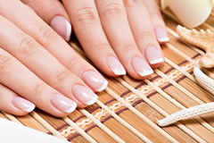 Woman in a nail salon receiving manicure Stock Photo