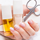 Woman in a nail salon receiving manicure Royalty Free Stock Photo