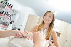 Woman in nail spa. Woman in a nail spa stock photos