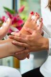 Woman in nail studio receiving pedicure Royalty Free Stock Image