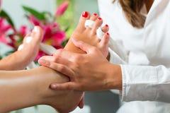 Woman in nail studio receiving pedicure Stock Photo
