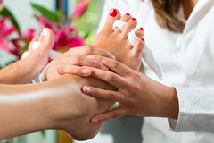 Woman in nail studio receiving pedicure Royalty Free Stock Photo