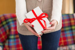 Woman with nail varnish holding gift Stock Photo