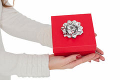 Woman with nail varnish holding red gift Royalty Free Stock Images