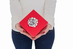 Woman with nail varnish holding red gift Royalty Free Stock Photo