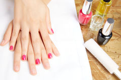 Before and after woman nails treatment in saloon Stock Image