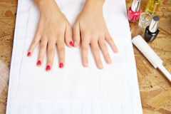 Before and after woman nails treatment in saloon Royalty Free Stock Photos