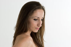 Woman with Naked Arms Isolated on White Background. Young Woman with Naked Arms and Long Brown Hair Isolated on White Background Royalty Free Stock Photography