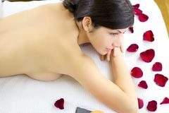 Woman naked waiting for massage in spa Stock Photo