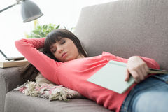 Woman napping on the sofa royalty free stock photos