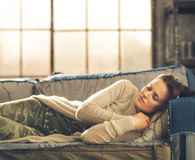 Woman napping on a sofa in a city loft Royalty Free Stock Image