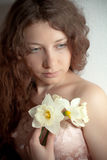 Woman with narcissus Stock Photography