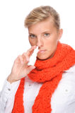 Woman with nasal spray. Full isolated portrait of a caucasian woman with nasal spray Stock Images