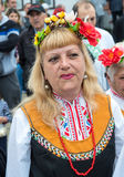 A woman in a national costume at the Nestinar Games in Bulgaria. Bulgaria is the only country in the world where barefoot people dance on red-hot charcoal. The Stock Photo