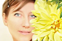 Woman natural Face with yellow. Woman Face with flower Royalty Free Stock Photography