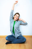 Woman natural portrait seatting on a floor. White background is Royalty Free Stock Image