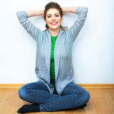 Woman natural portrait seatting on a floor. White background is Stock Photography