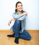 Woman natural portrait. Smiling girl seat on a floor. White bac Royalty Free Stock Images