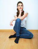 Woman natural portrait. Smiling girl seat on a floor. White bac Royalty Free Stock Image