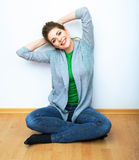 Woman natural portrait. Smiling girl seat on a floor. White bac Stock Photo