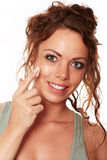 Woman with natural skin carries a face cream Royalty Free Stock Photo