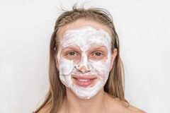 Woman with natural white cream mask on her face stock images