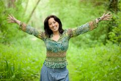Woman in nature. Happy woman enjoy freedom in verdant woods Stock Image