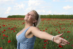 Woman in nature. Young woman relaxing. sun weather and poppy field Royalty Free Stock Images