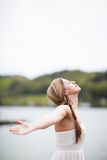 Woman in nature. A beautiful young woman spreading her arms in the nature Stock Photos
