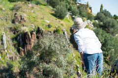 Woman in nature from behind. Standing and  looking far Stock Photo