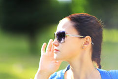 Woman on the nature in black sunglasses Stock Image