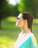 Woman on the nature in black sunglasses Royalty Free Stock Photography