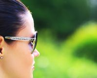 Woman on the nature in black sunglasses Royalty Free Stock Photos