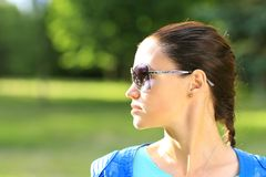 Woman on the nature in black sunglasses Stock Photography
