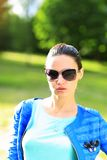 Woman on the nature in black sunglasses Stock Photos