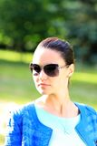 Woman on the nature in black sunglasses Stock Images