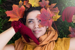 Woman in nature with fall leaves, top view Royalty Free Stock Photography