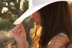 Woman in the nature with hat Stock Photo