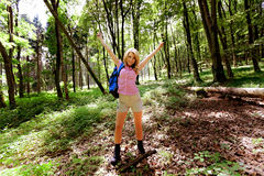 Woman in nature while hiking. Young Woman in nature forest while hiking Royalty Free Stock Photography