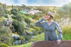 Woman  in nature listening sound Royalty Free Stock Photo