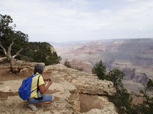 Woman nature photographer at the Grand Canyon Royalty Free Stock Photo