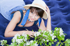 Woman on nature with the sprigs of flowering apple Stock Image