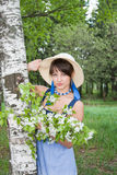 Woman on nature with the sprigs of flowering apple Royalty Free Stock Image