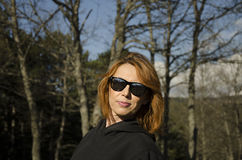 Woman in nature. With sunglasses Royalty Free Stock Photo
